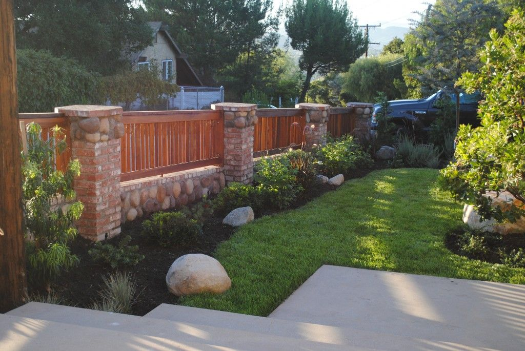 extraordinary wooden fence on brick wall house