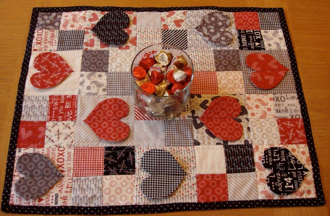 2.5 inch squares and 4.5 square with heart applique mini quilts