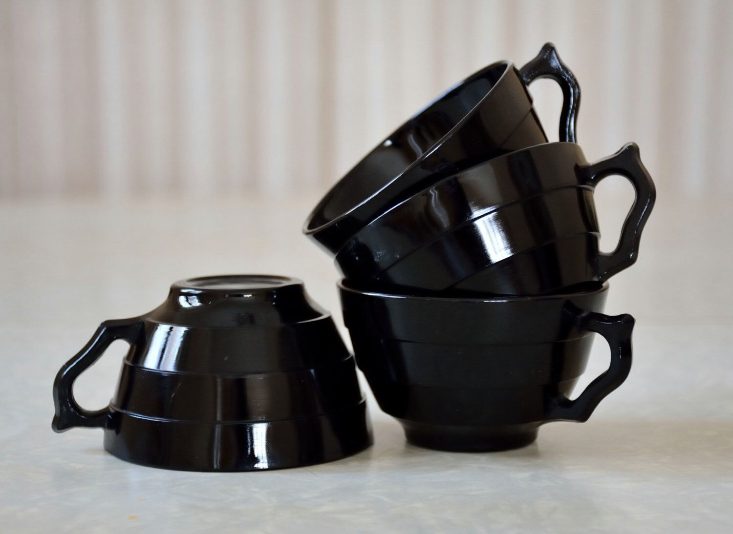 Set of four black Moderntone cups by Hazel Atlas, hard to find in black, Mid Century Glassware, Depression Glass by TheLadenBranch on Etsy https://www.etsy.com/listing/262719982/set-of-four-black-moderntone-cups-by