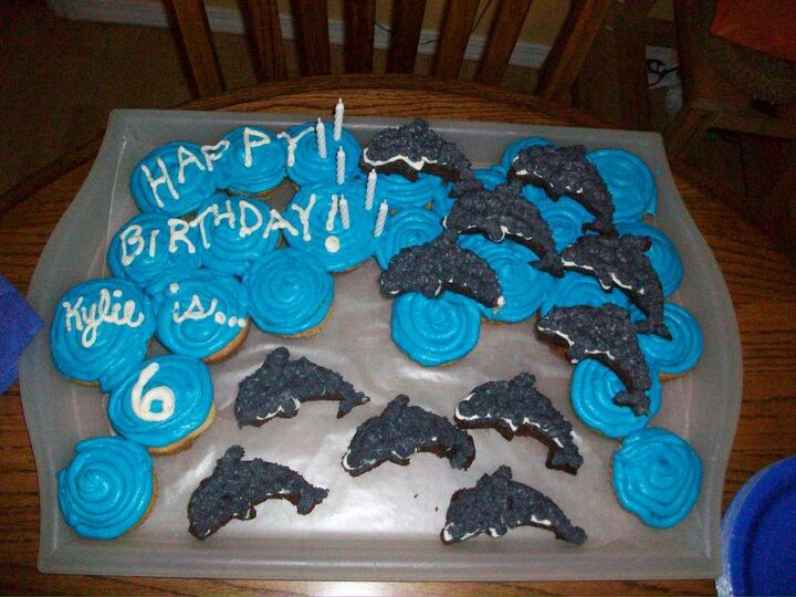 Dolphin theme birthday. Cupcakes and dolphins are cut out brownies