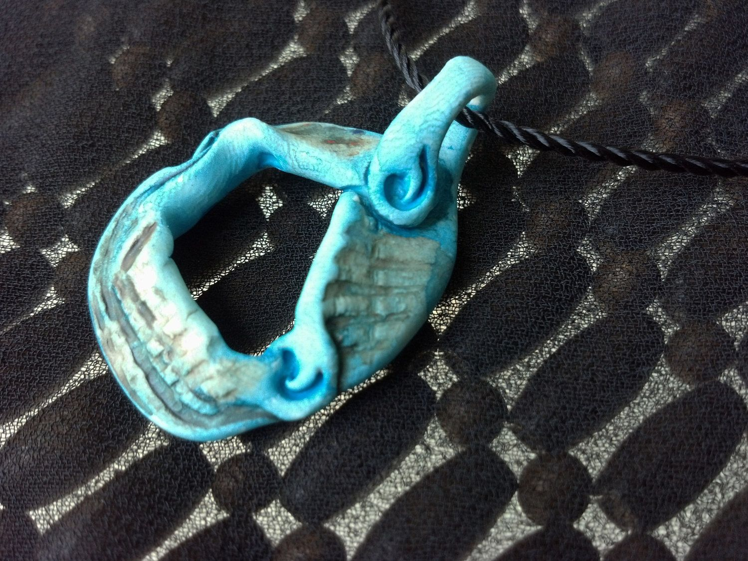 Wave Handcrafted Polymer Clay Pendant with Acrylic Wash. $18.00, via Etsy.