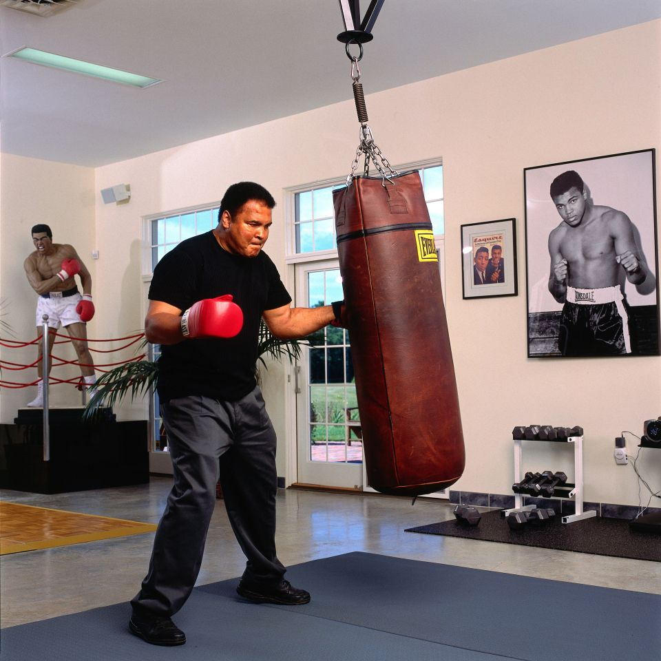 Home Gym Heavy Bag: Ali Hitting Heavy Bag In His Home Gym Portrait Of Former