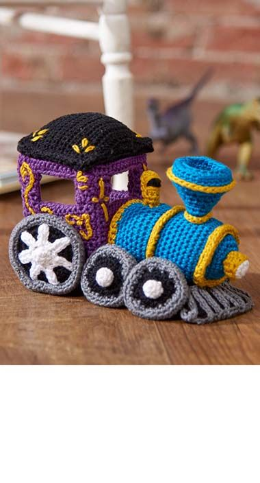 Choo Choo! Car number one in a four-car series, this decked-out circus crochet train engine comes complete with whistle and cow catcher. Customize it with gold pinstriping to make your locomotive extra special.