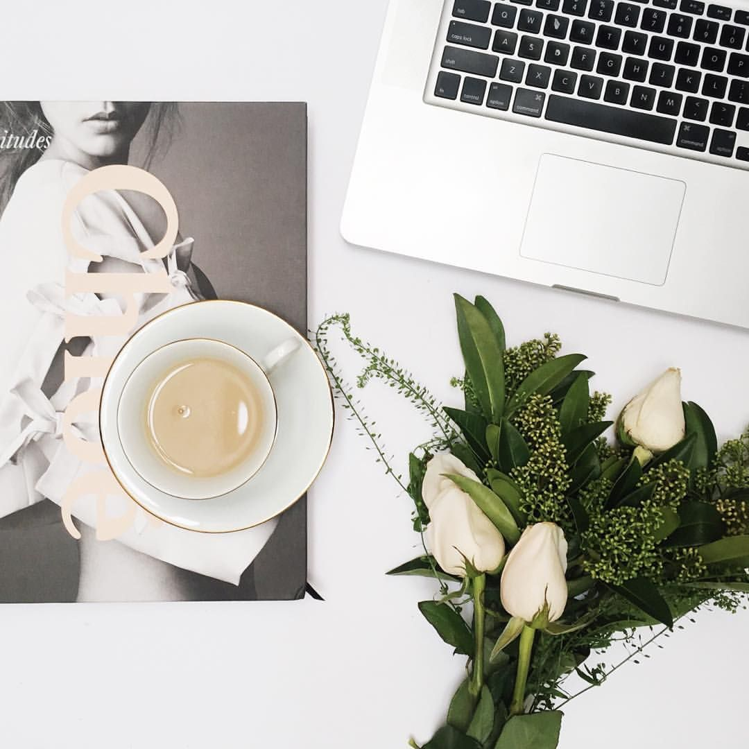 pretty desk, tea, flowers & a coffee table book while you work it