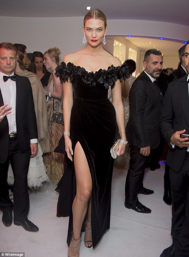 Beauty: Karlie Kloss turned heads during the night in an old-school suede black off-the-sh...