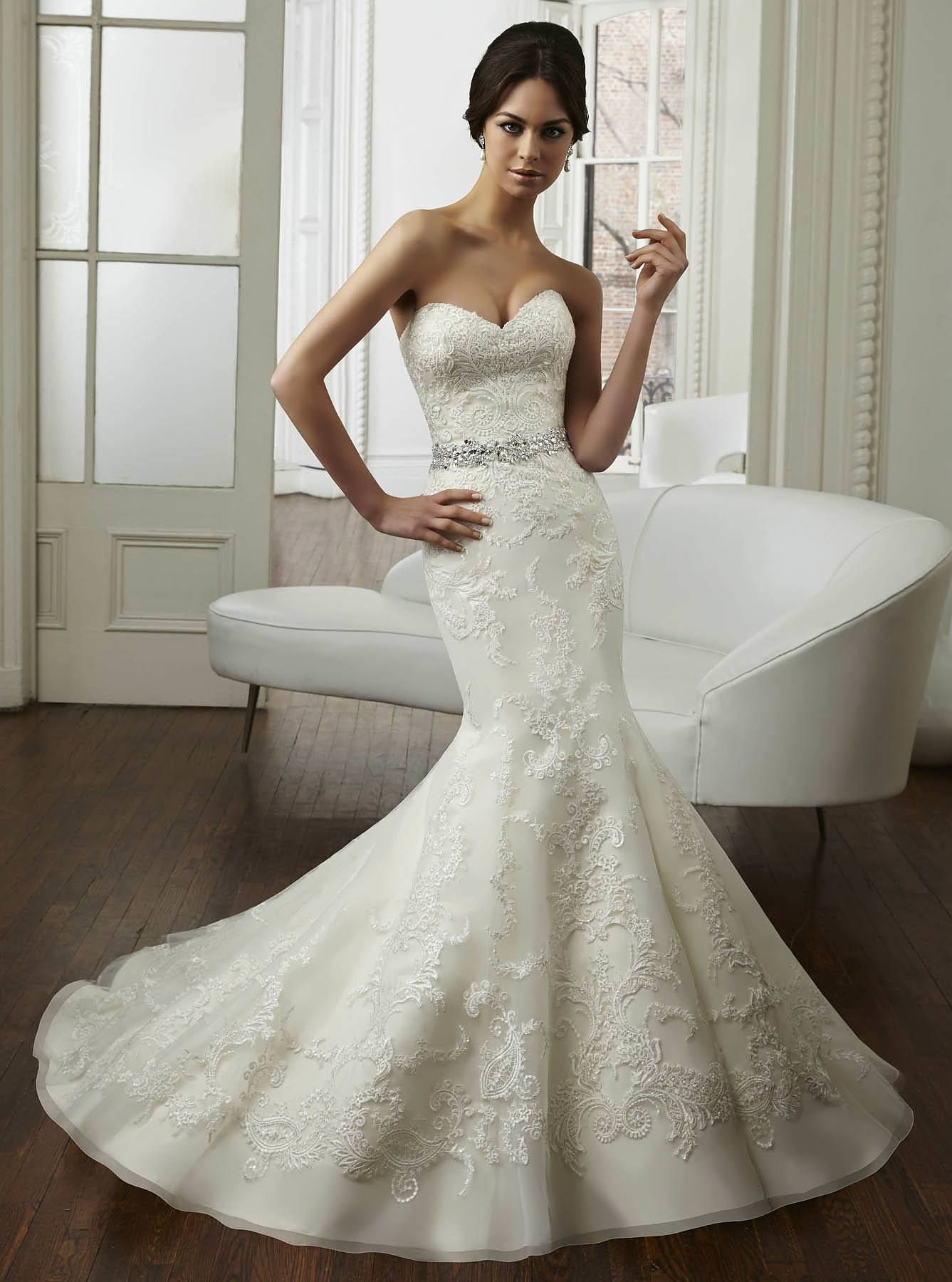 Mermaid wedding dresses with lace  A mermaid wedding gown with ornate embroidery with wide hem border