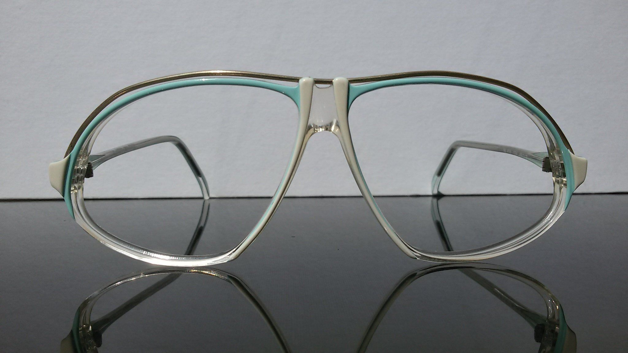 773e47747d €60 Men s eyeglasses for Novelle Ligne. Aviator shape in white and pale  blue. The top of the frame is decorated with gold colored wire.