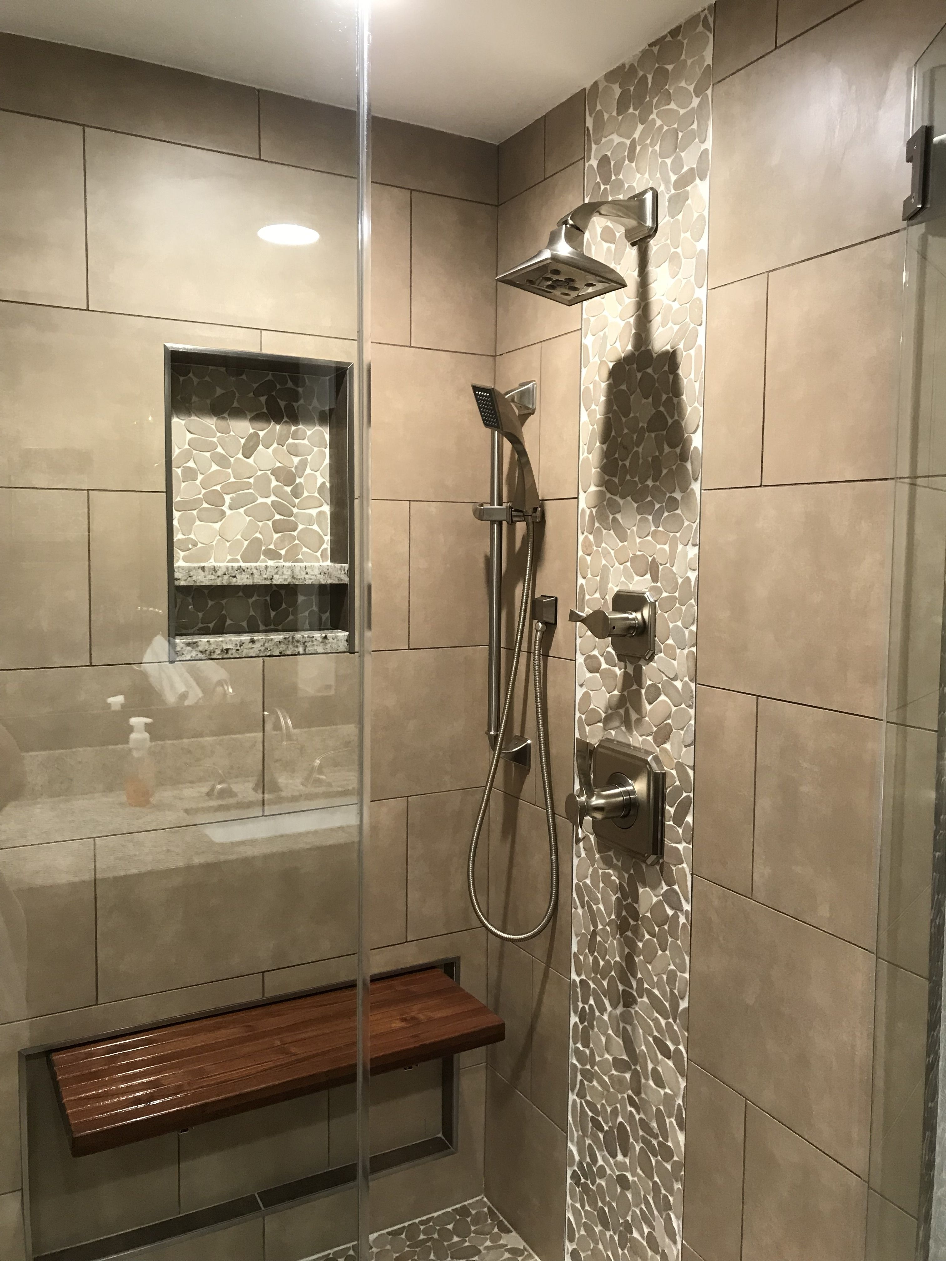 Great looking bathroom shower remodel with Sliced pebble mosaics and ...