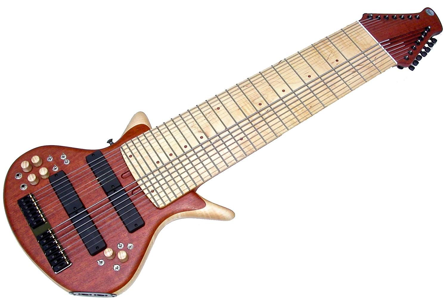 "Warr Phalanx 14-String Guitar by Warr Guitars ( founded 1991 by Mark Warr). 14 Piëzo / 12 MIDI .Pudauk top. Curly Maple body core. Slightly figured Maple fingerboard. Maple / Pudak / Curly Maple knobs. Designed specifically for the ""uncrossed"" tunings.Bass side is tuned as a standard 6-string bass, and the guitar side is tuned an octave above, making touch-style playing easier for musicians accustomed to standard bass and guitar tunings. These guitars are often used for tapping like a…"