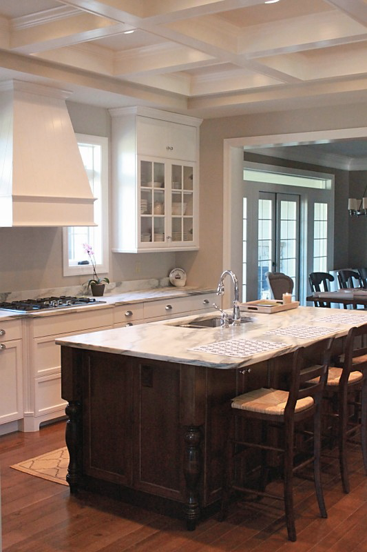 Jenny Steffens Hobick: Jill's Kitchen | White Marble, Stained Island, Cream Painted Glass Front Cabinets & Polish Silver Hardwar #whitemarbleflooring