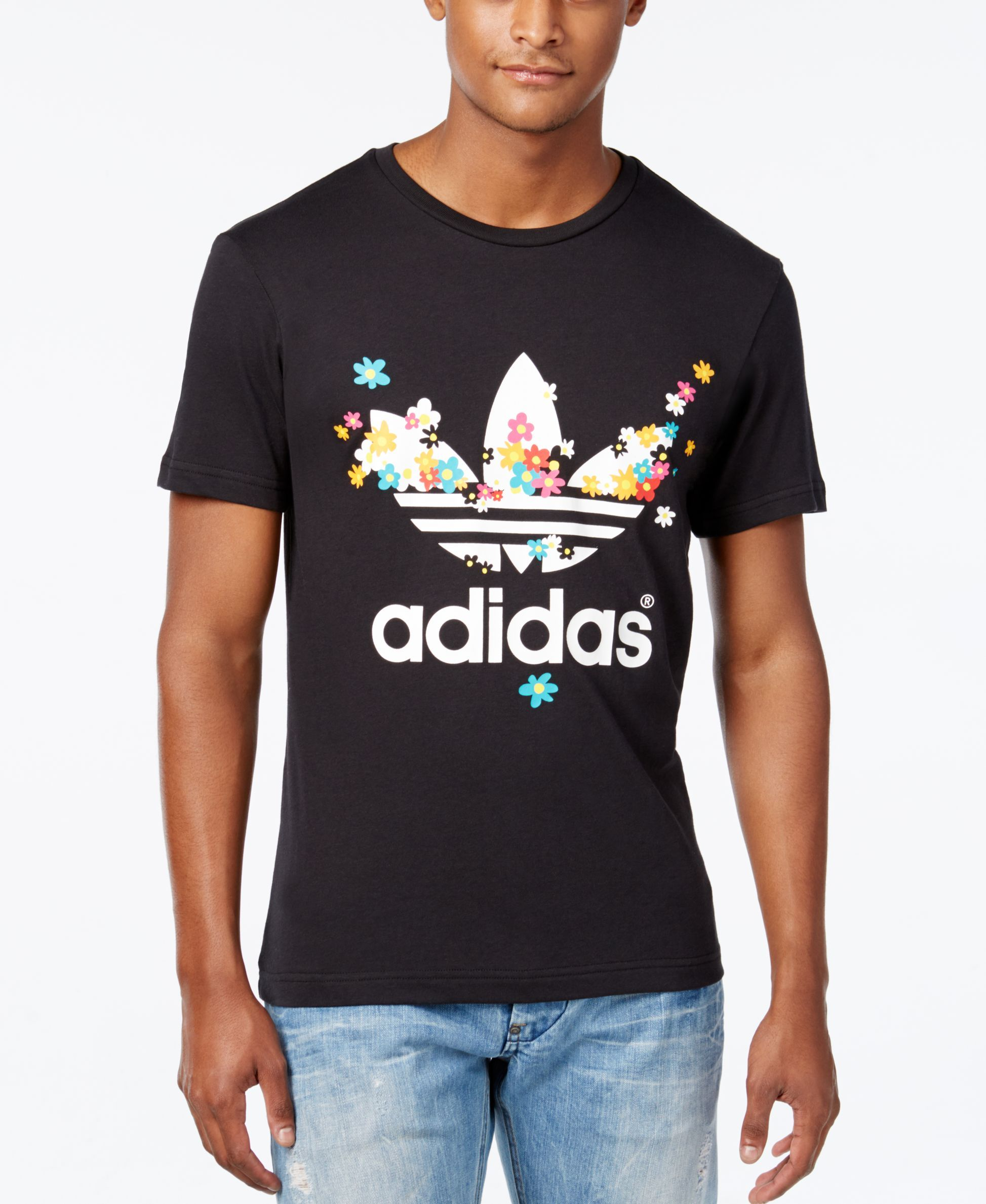 40fc898a A t-shirt in floral graphics designed by Pharrell Williams. Musician and…