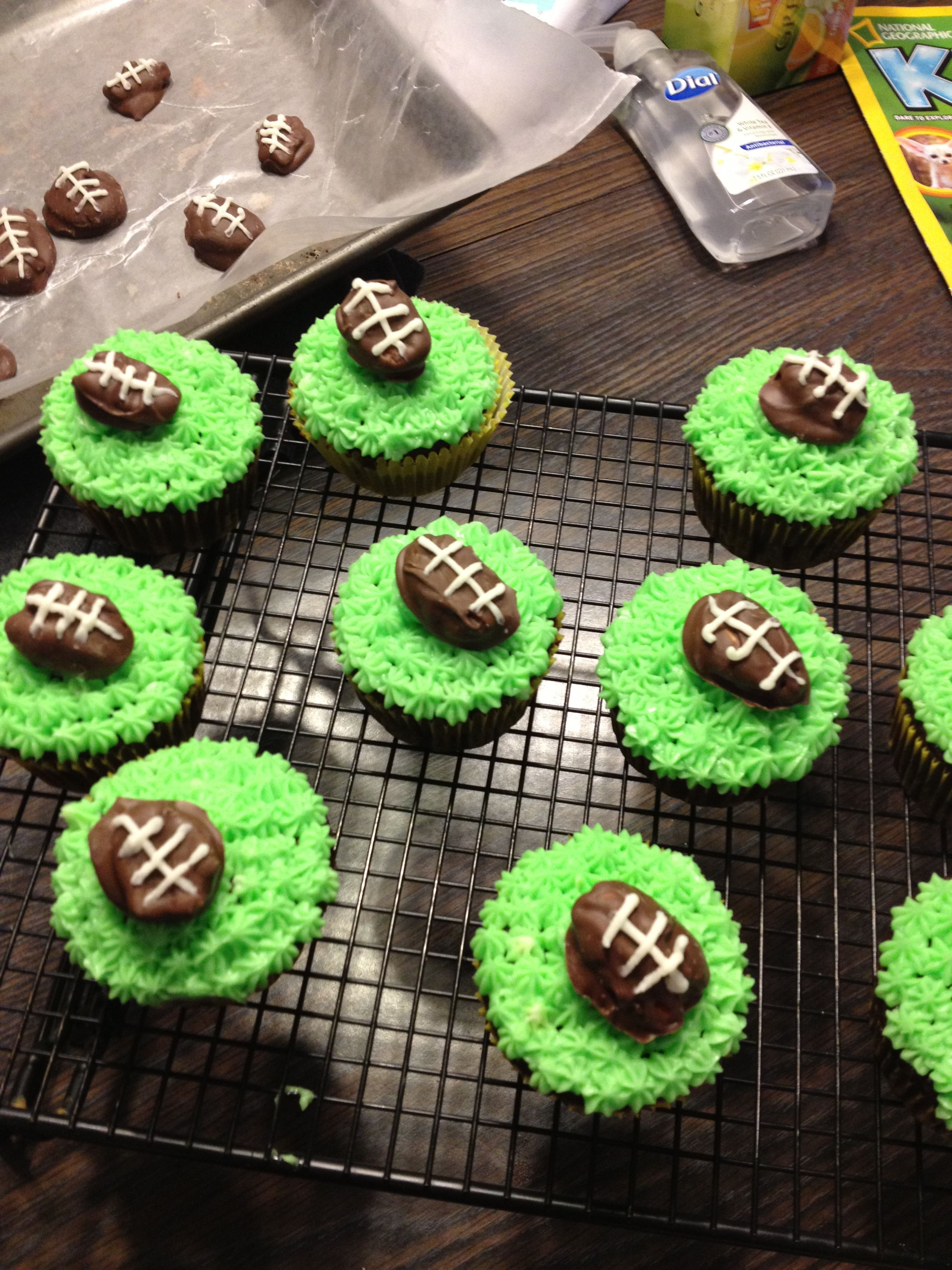 Super Bowl cupcakes: chocolate covered pecan football and star decorating  tip with green icing for grass