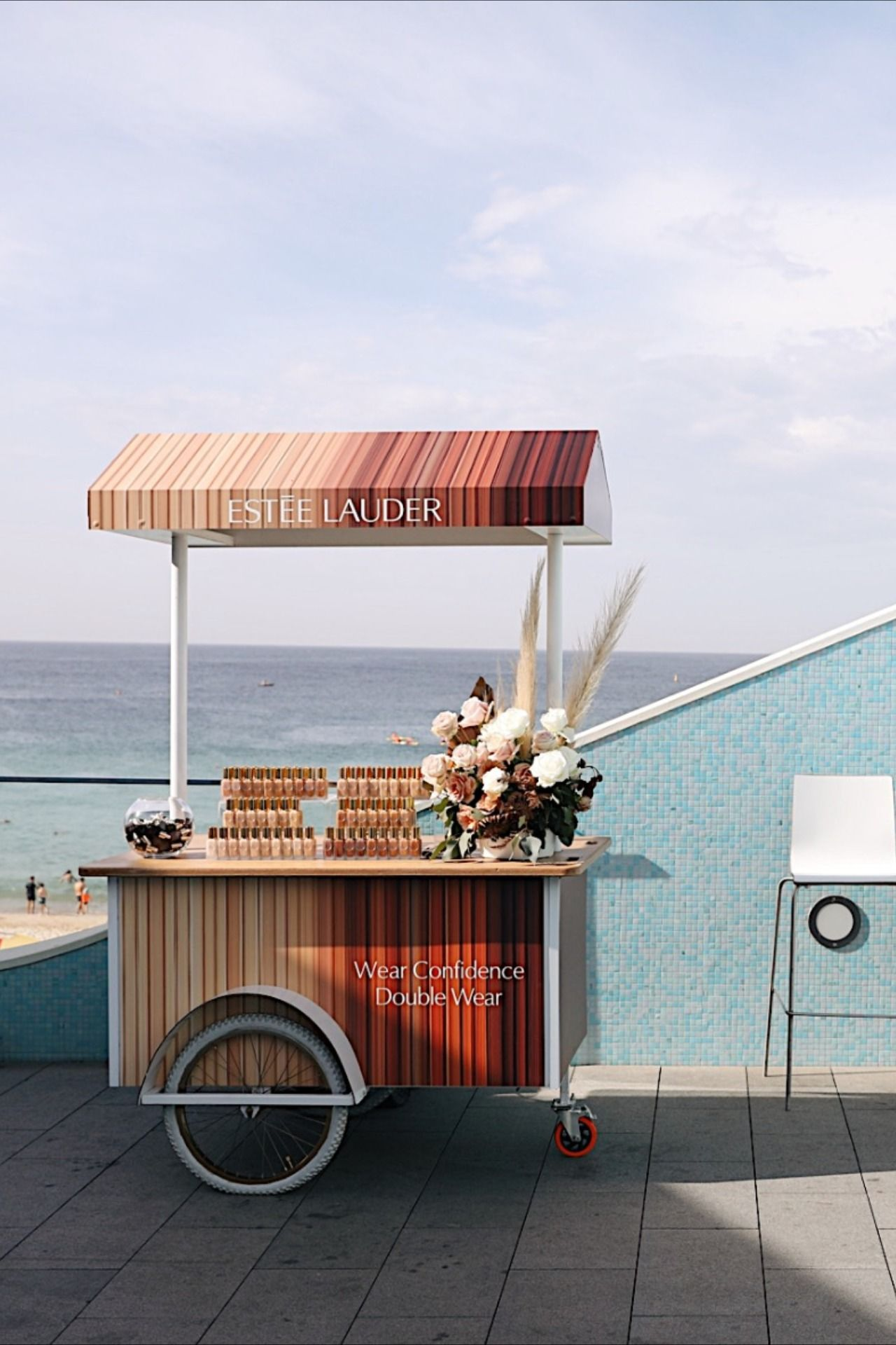 Our fully branded canopy carts for Estee Lauder new foundation launch at Bondi Beach. We created customised smoothies for this event to match the new range colours. #event #medialaunch #brandactivation #brandevent #eventcatering
