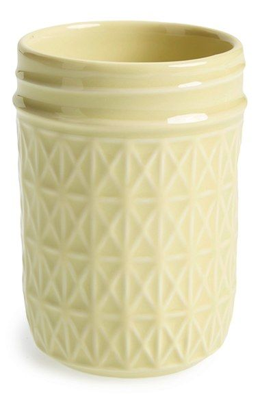 This adorable ceramic jar would make a cute vase when picking flowers from the garden.