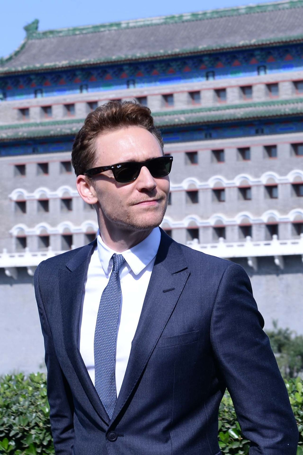Tom Hiddleston poses for photos during a photocall in front of the Qianmen on October 11, 2013 in Beijing, China [HQ]
