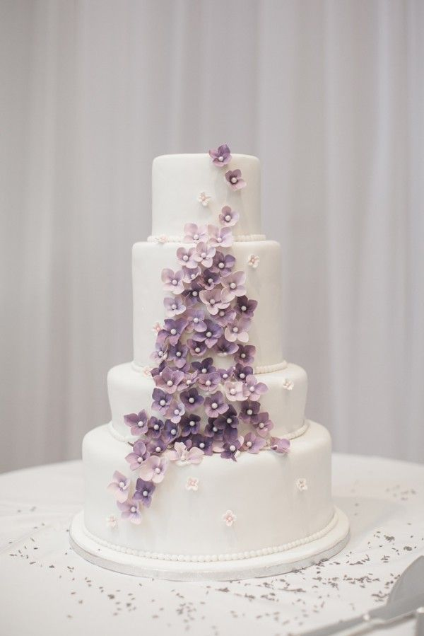 A french country inspired wedding in toronto ontario purple white wedding cake with purple flowers mightylinksfo