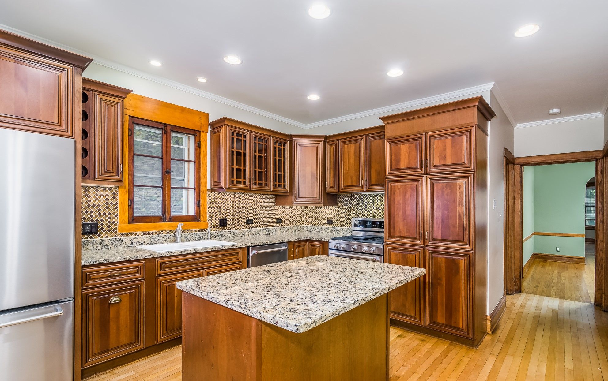 Vintage Style Kitchen With Cherry Cabinets Hardwood Floors Brown