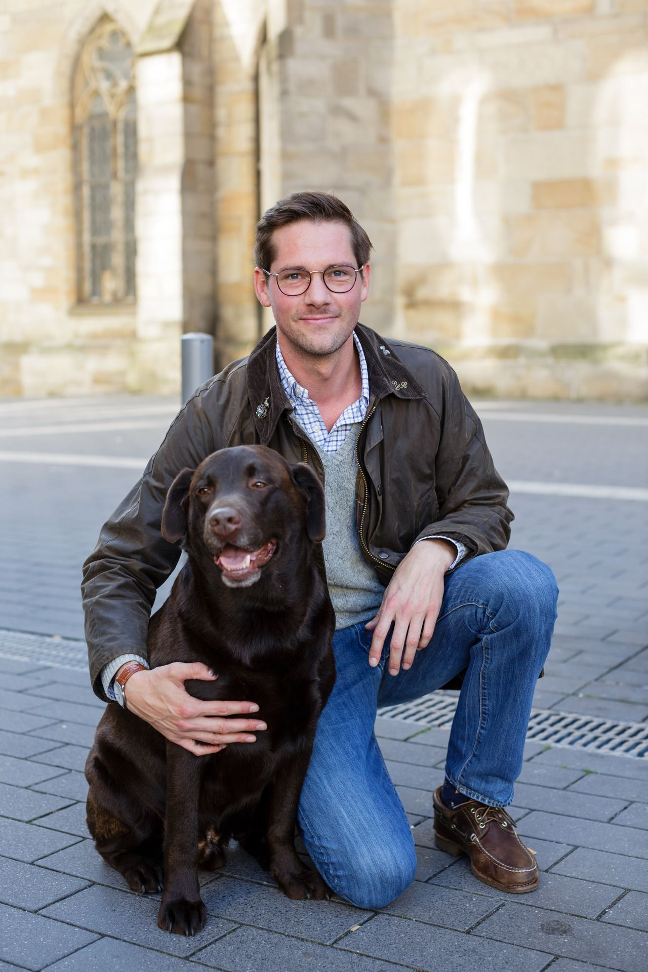 29df5841b91 We spotted Philip in his Barbour wax jacket with his labrador on a sunny  day in Dortmund.