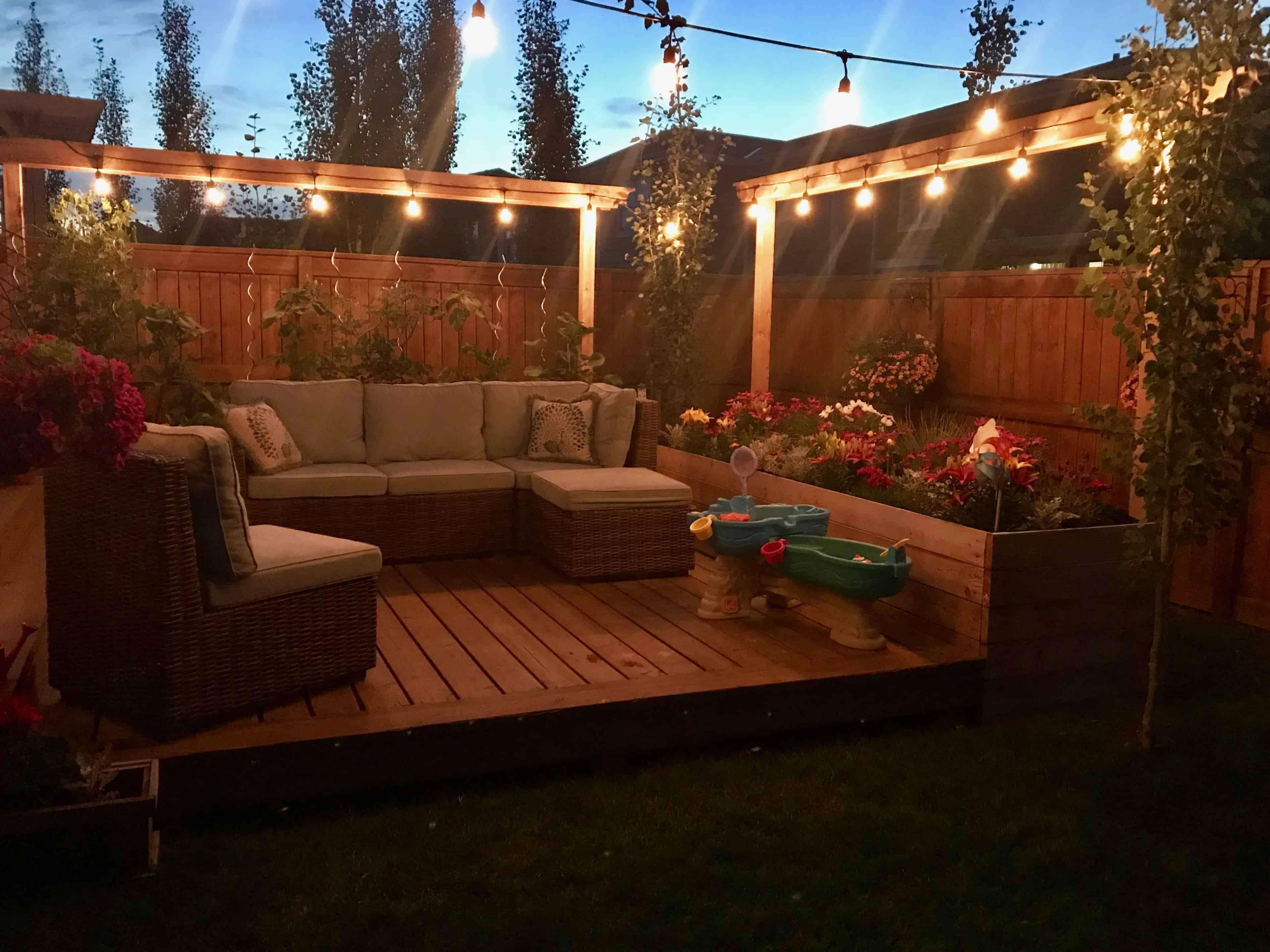 Make the most of your summer by creating a fun space for kids and adults in your own backyard. Check out this post for tips to make your backyard, weather big or small, a fun and inviting place for your family. | family fun | backyard activities | small yard | family memories | backyard for kids | #smallbackyard #kidfriendlybackyard #ourhappyhive