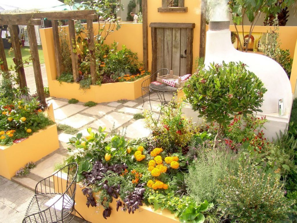 Mediterranean Garden With Pergola And Yellow Walls | Pergolas ...