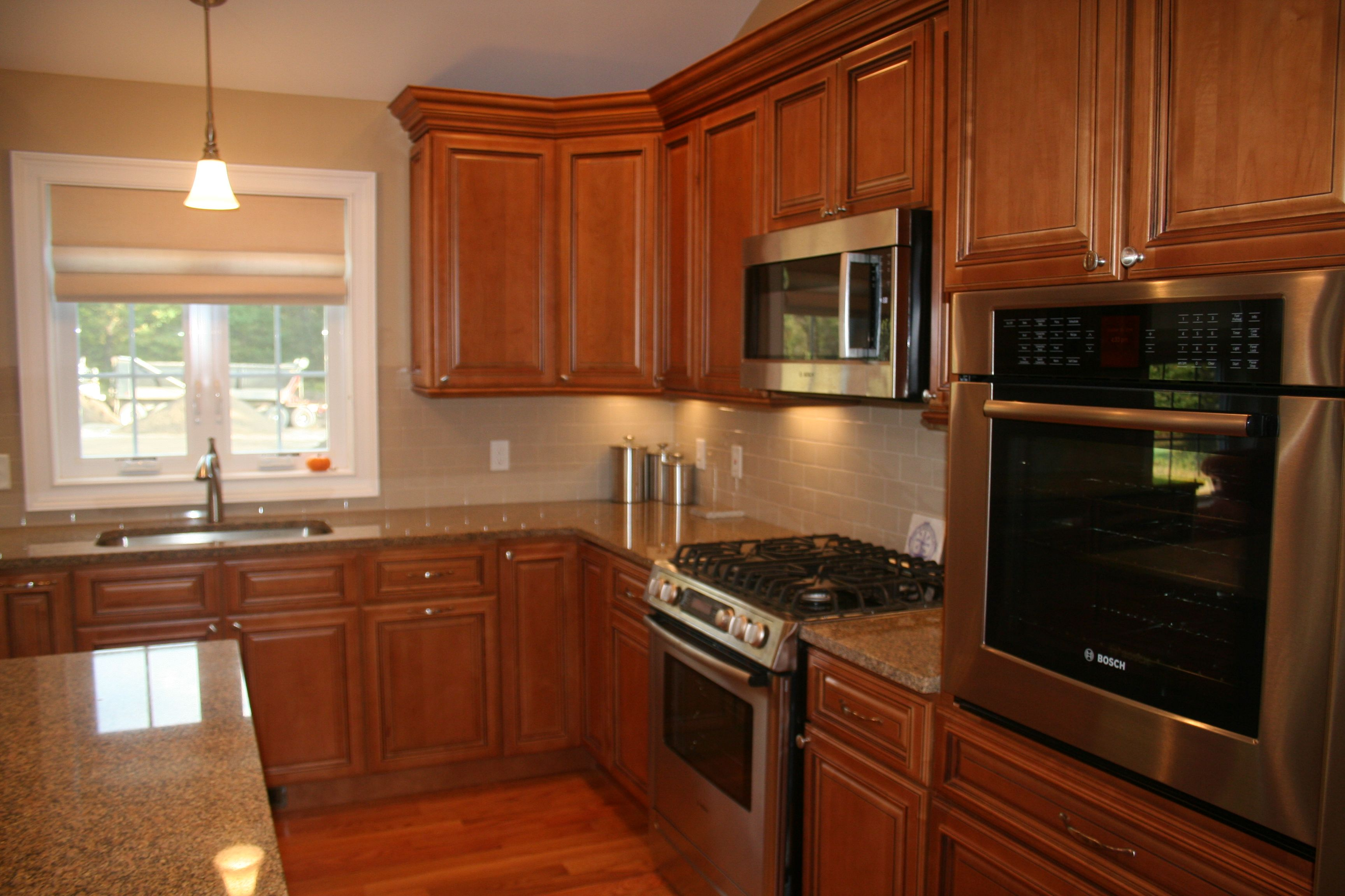 traditional new build kitchen with dark raised panel wood cabinets rh pinterest com