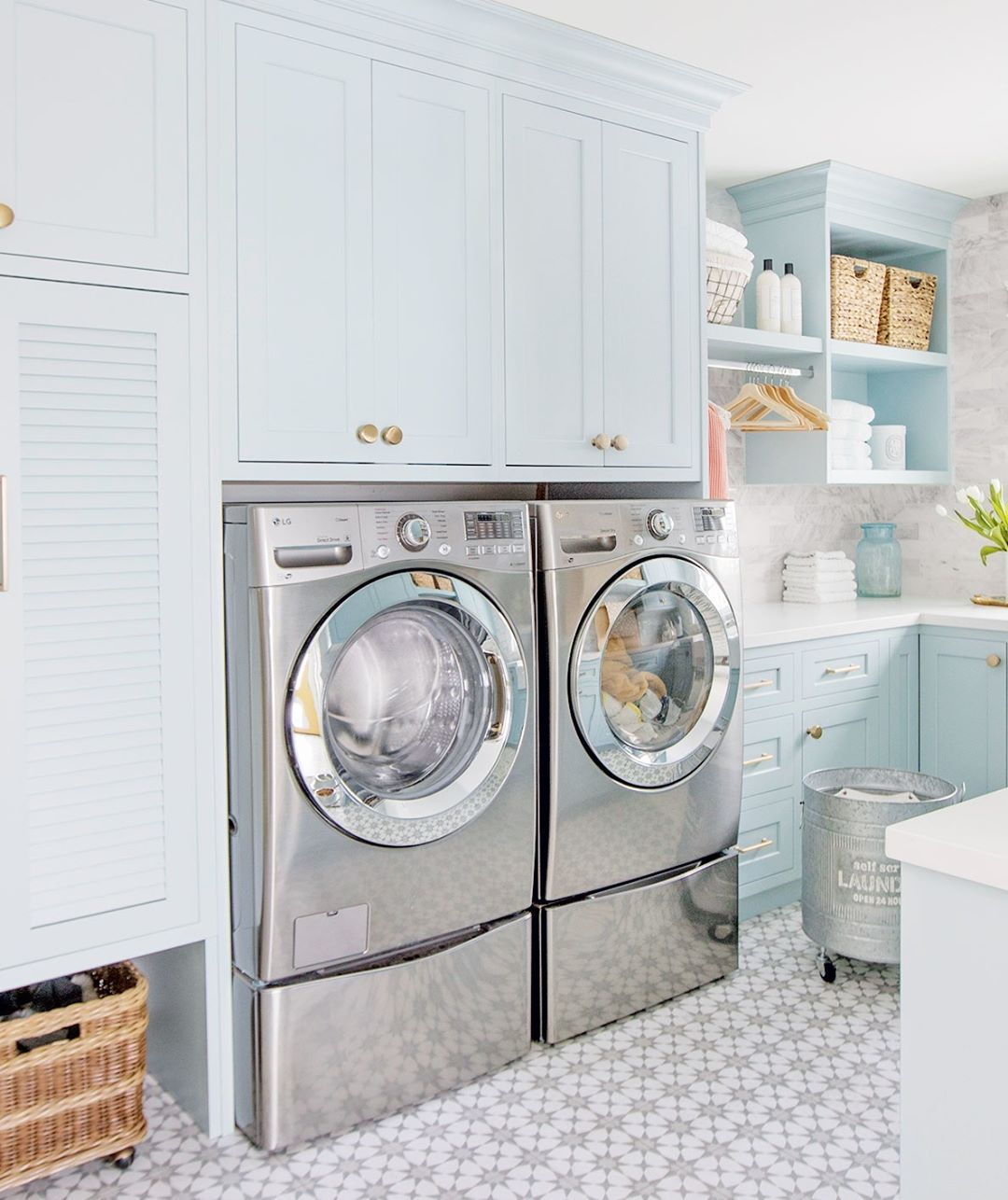 Choosing A Front Loading Washer And Dryer Meant More Cabinets