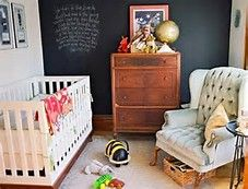 Chalkboard walls look nostalgic next to a wooden dresser like this.