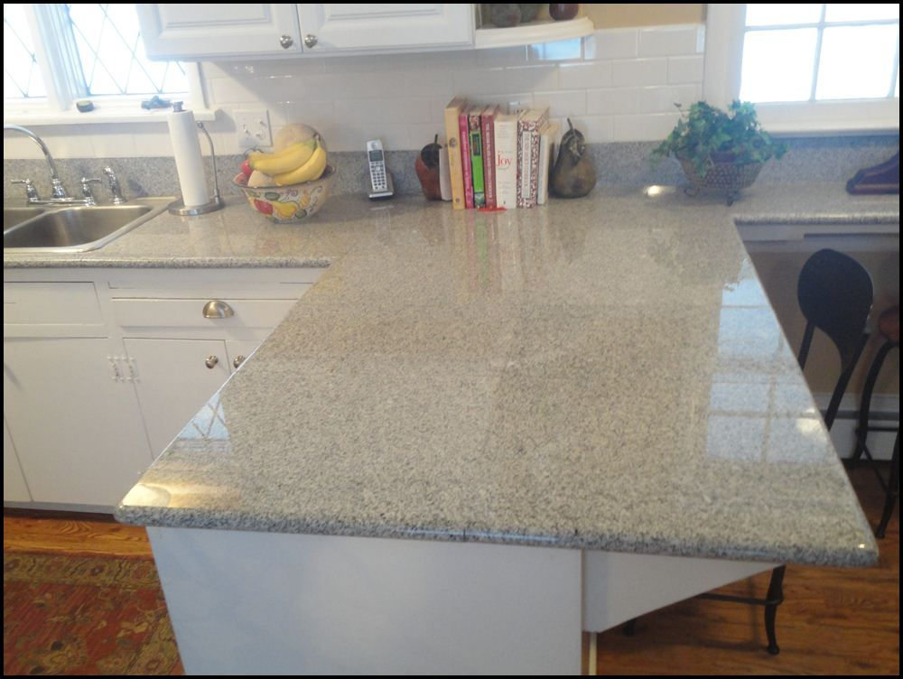 Here We Have A Kitchen Completed In Imperial White Lazy Granite Tiles Instead Of Using
