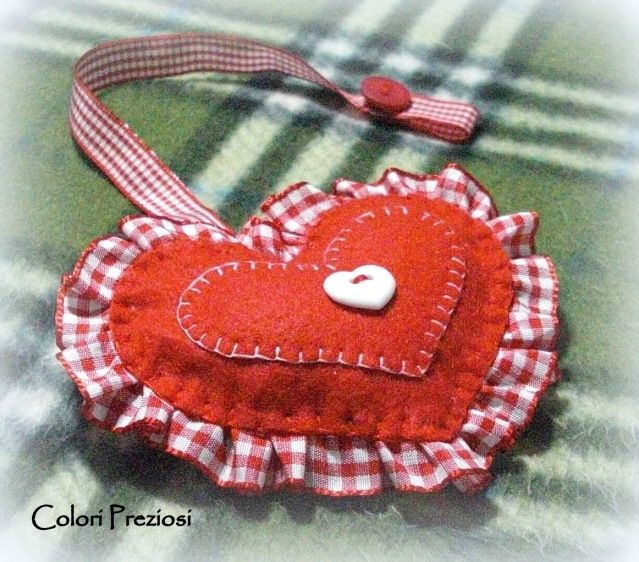 Brooch with little and red felt heart for pacifier.