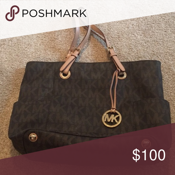Brown Michael Kors Tote ✨ 100% Authentic ✨ Great Exterior Condition..Wear on the handles but still in GREAT CONDITION  ✨ Small Stains on the Inside Fabric, CAN BE REMOVED  ✨ Smoke Free Home  Ships Immediately! No trading at this time.   BUNDLE & Save 20% 💗 MICHAEL Michael Kors Bags Totes