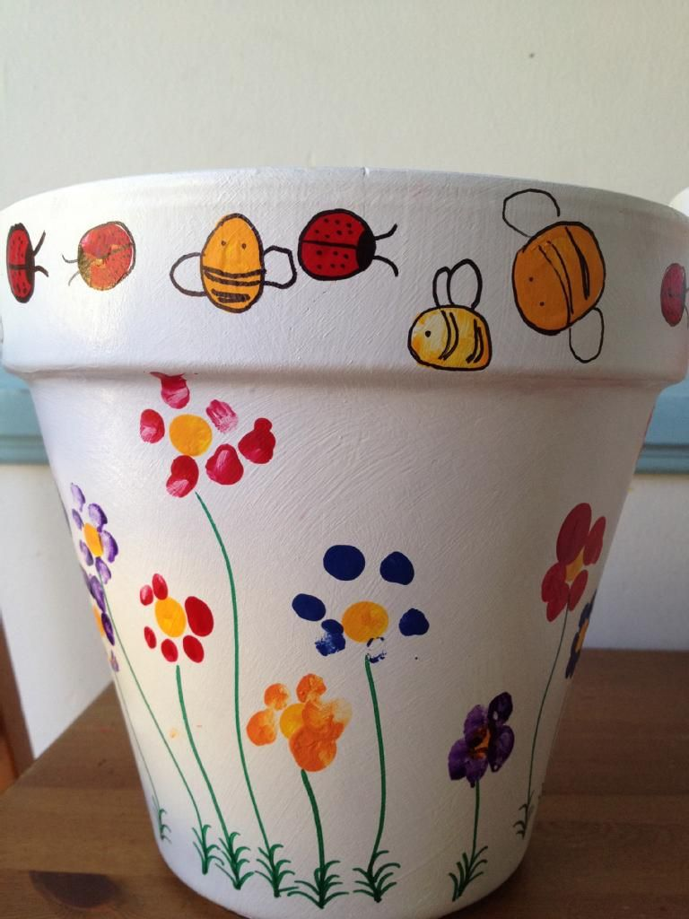 each child has made their mark on the large flower pot! using their