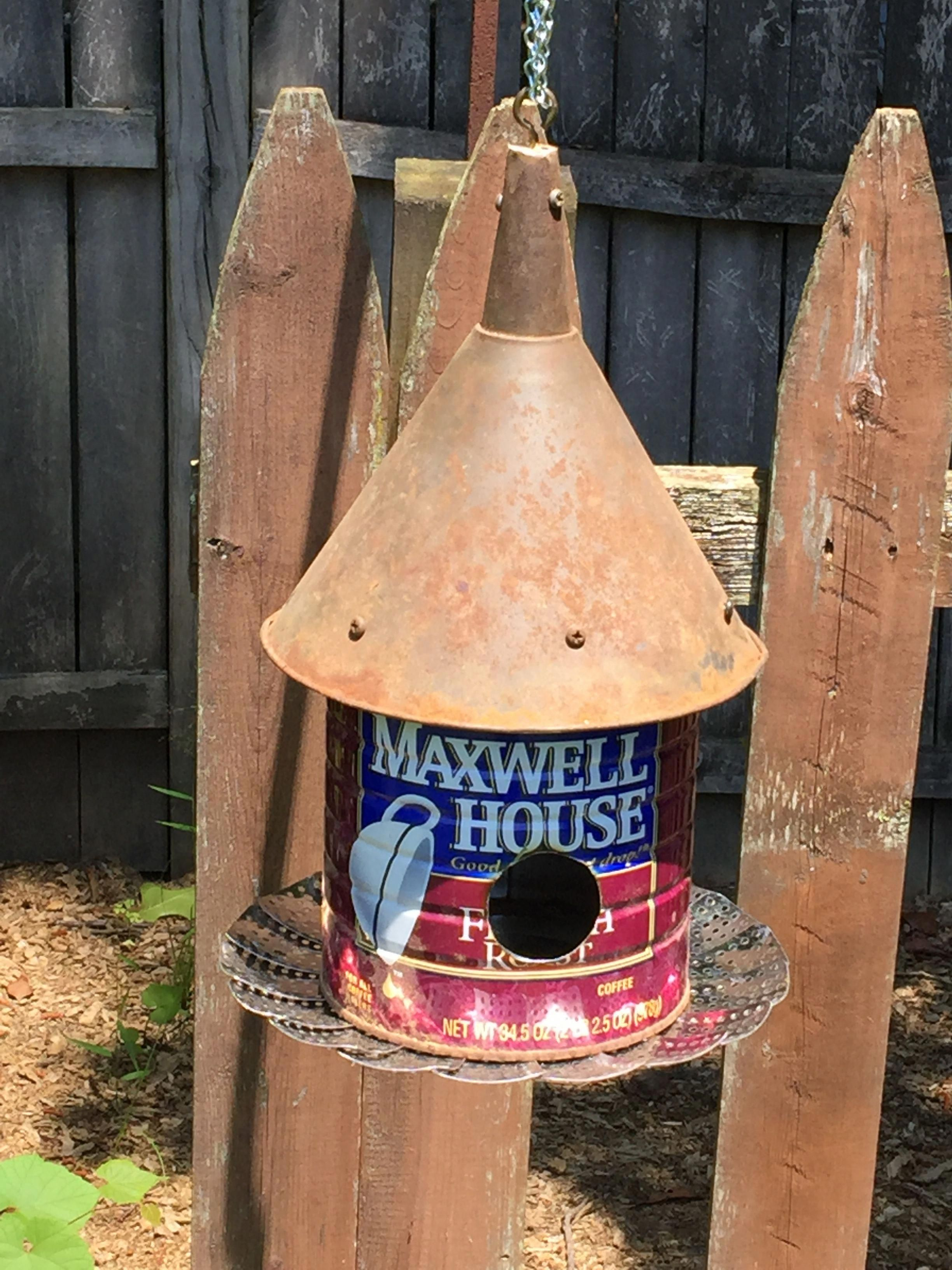 Made this birdhouse from a steamer, coffee can and funnel