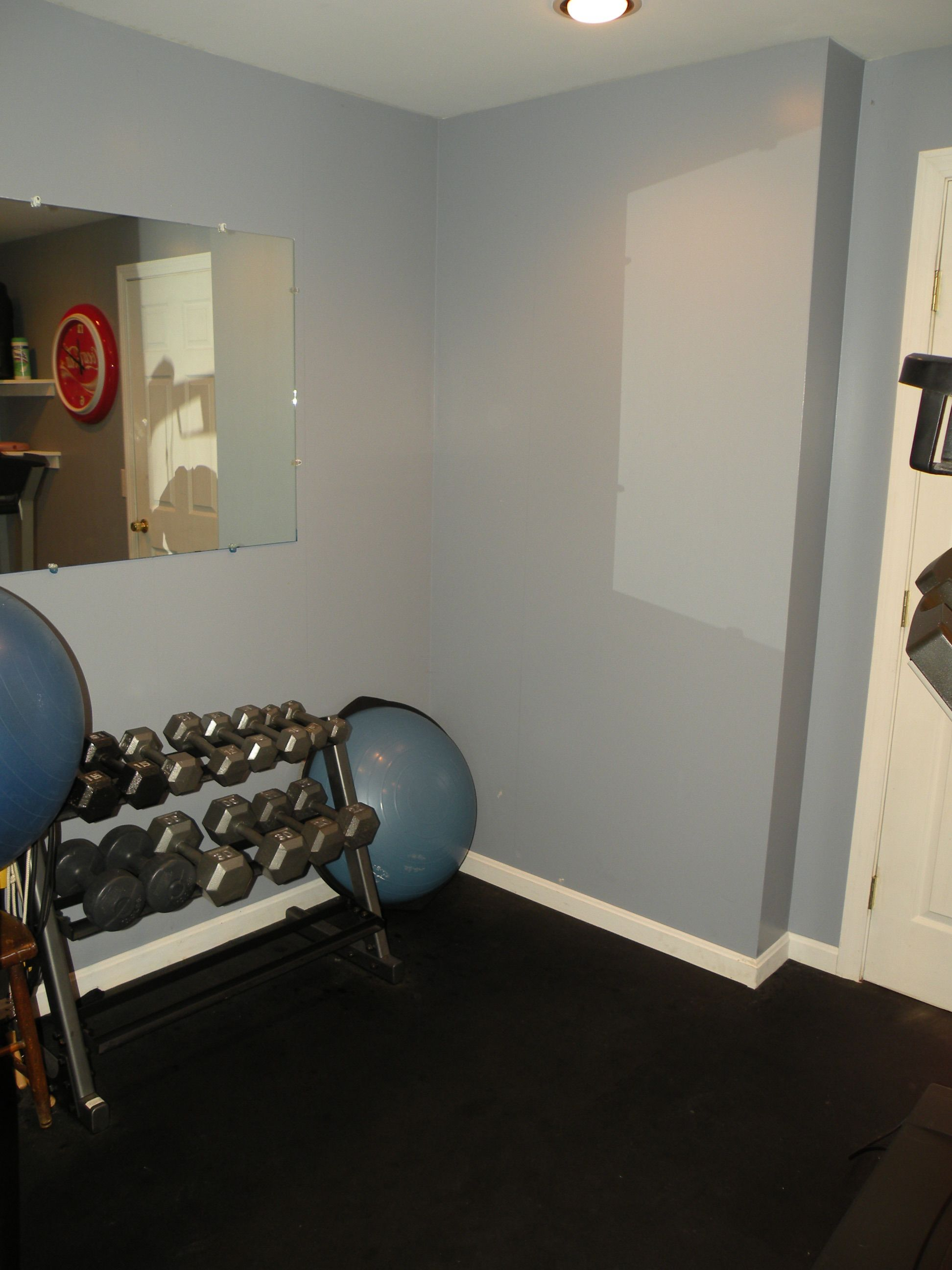 Workout room grey wall ball weights mirror white trim