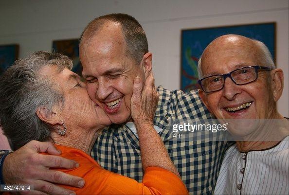 News Photo Al Jazeera Journalist Peter Greste Is Kissed By