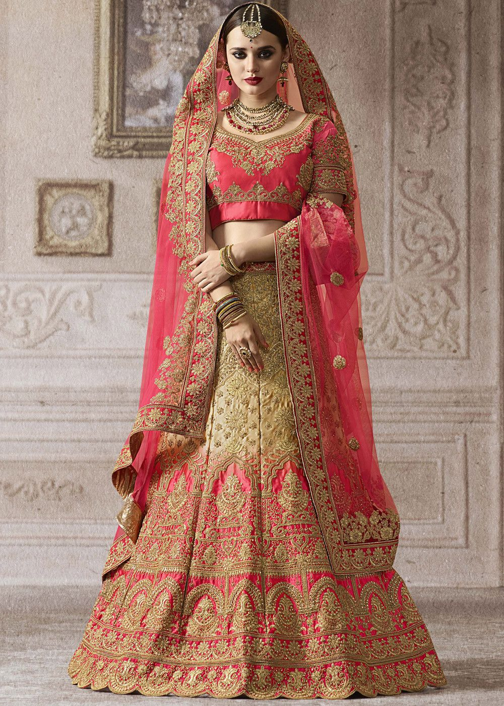 50301a007f Be the prettiest bride in this beige and pink shaded #bridal #lehenga  embellished with all over heavy zari embroidery and kundan work.