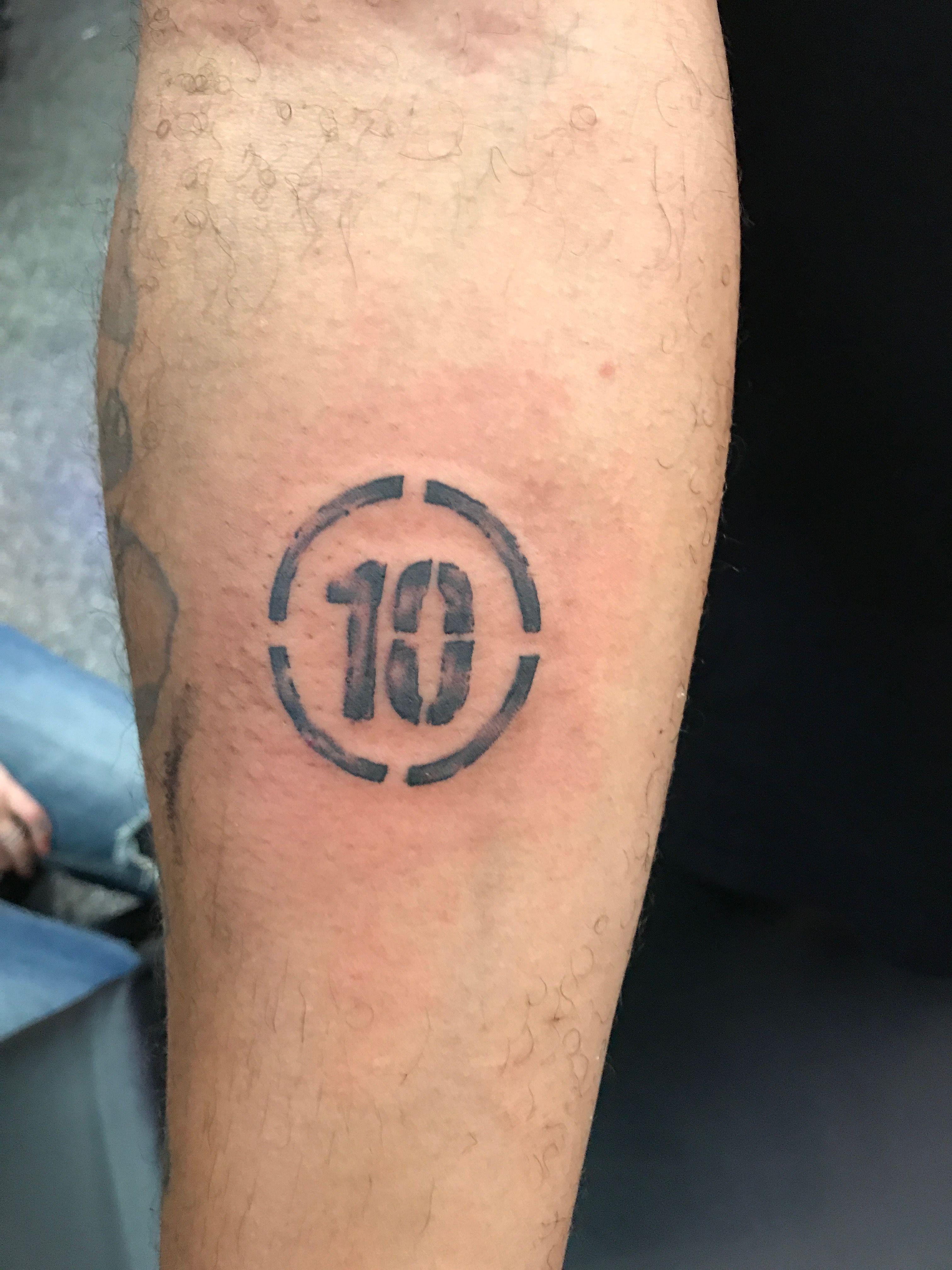 Number 10 number stamp wrist tattoo