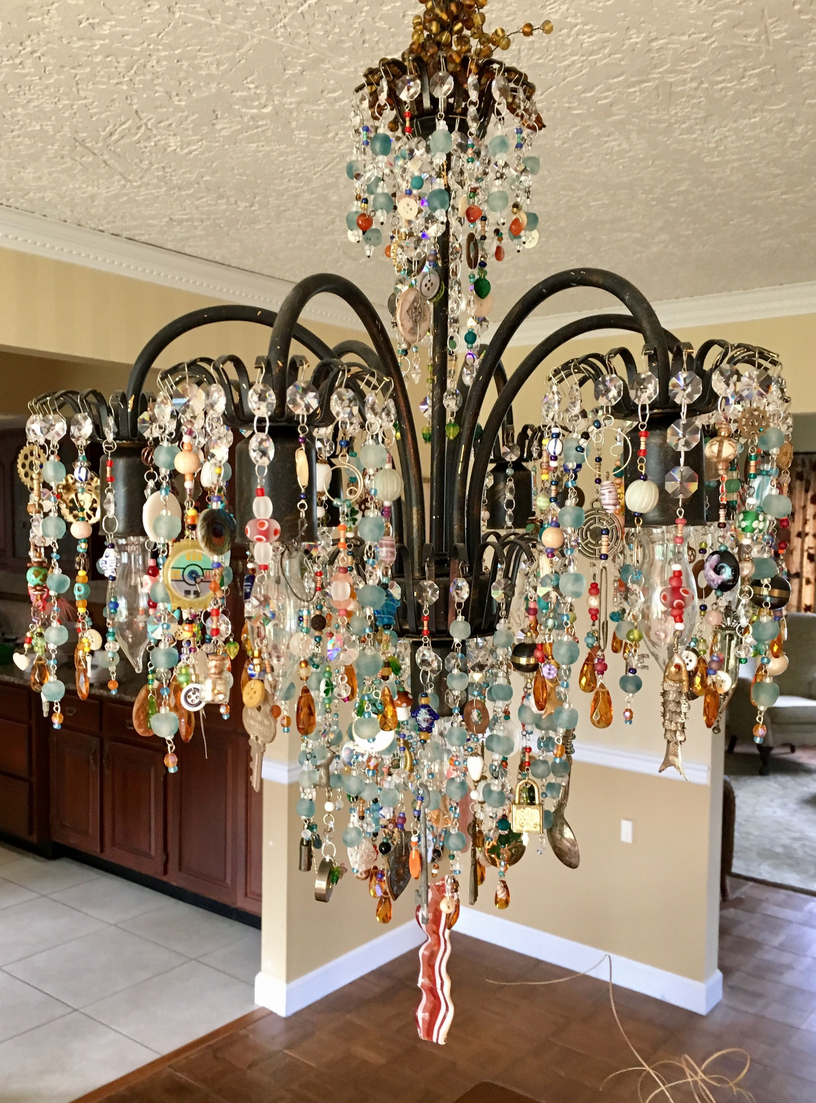 Upcycled Chandelier With Found Objects Shells Watches Fishing Lures Crystals Stones