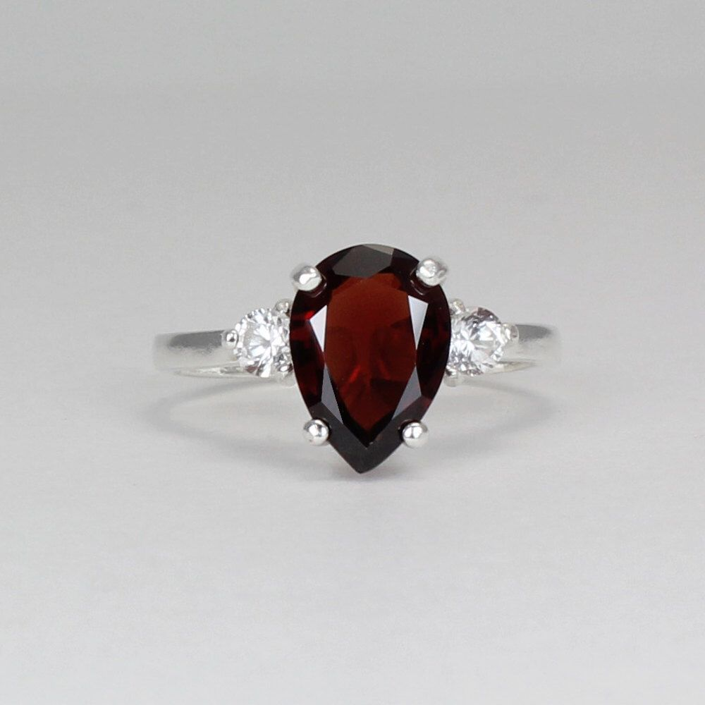 Sterling Silver Garnet Ring with Sapphires / Garnet Silver Ring January Birthstone FREE RE-SIZING by TSNjewelry on Etsy https://www.etsy.com/listing/160307818/sterling-silver-garnet-ring-with