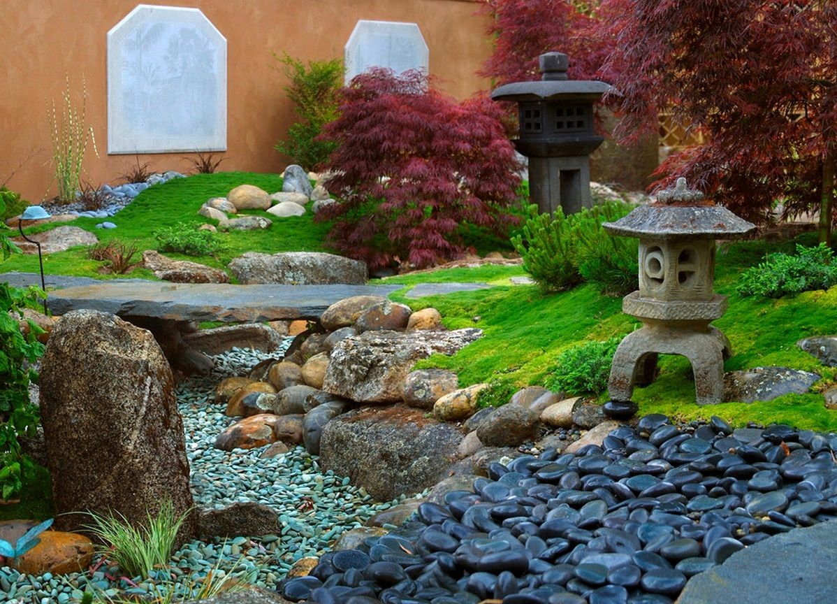 stone lamps plants and patios in backyard garden of modern home