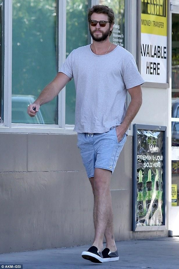 485a23288985 Liam Hemsworth wearing Vans Multicolor Slip-on Pro