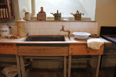 The Victorian kitchen at Powderham Castle, near Exetor, Devon.The lead lined kitchen sink.