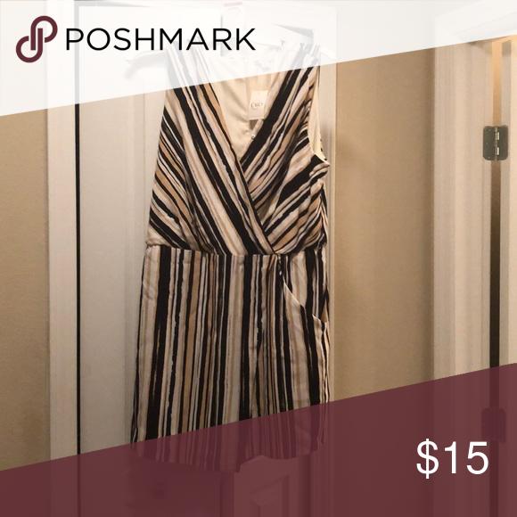 Women's romper Black, tan, and white stripe romper. Brand new Dresses