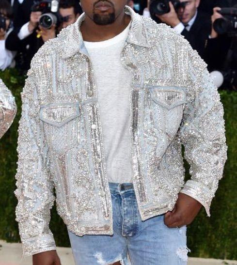 Kanye West At The 2016 Met Gala Wears A Custom Balmain Denim Jacket Fear Of God Jeans And Saint Laurent Boots Denim Fashion Balmain Jacket Jackets