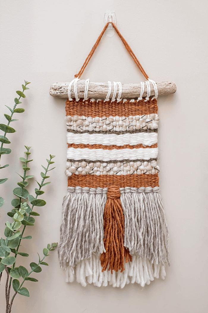 DIY woven wall hanging on driftwood hanger.