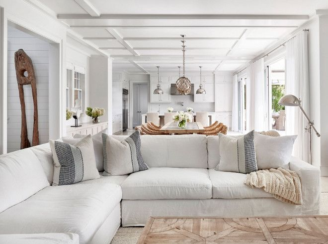 White Linen Sectional Hamptons Style Living Room With Coffered Ceiling White Linen Section Hamptons Beach House Coastal Living Rooms Contemporary Beach House