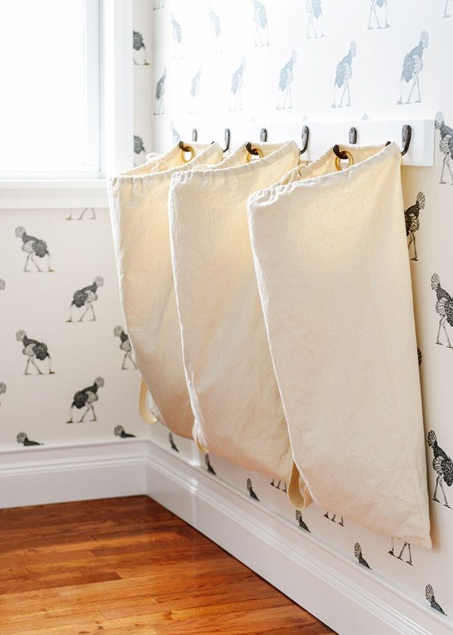 """If your laundry space isn't very big to begin with, you need some DIY laundry room organization! Use these awesome ideas for tiny laundry spaces to get the """"organized"""" back into your """"clean""""!"""