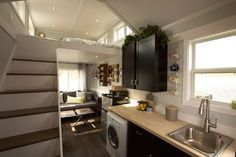 The interior of the Notarosa tiny house. A 250 sq ft tiny house made by Triton Home Builders.