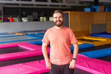 Fitness, fun, leisure and sport activity concept - Man smiling on a trampoline indoors , #AFF, #spor...