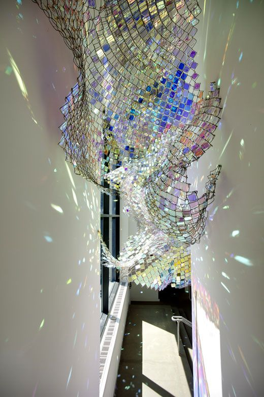 Iridescent Acrylic Plexiglas Squares Affixed Into Chain Link Suspended From The 3rd Floor Undulates And Refracts Turned Art Glass Art Sculpture Installation