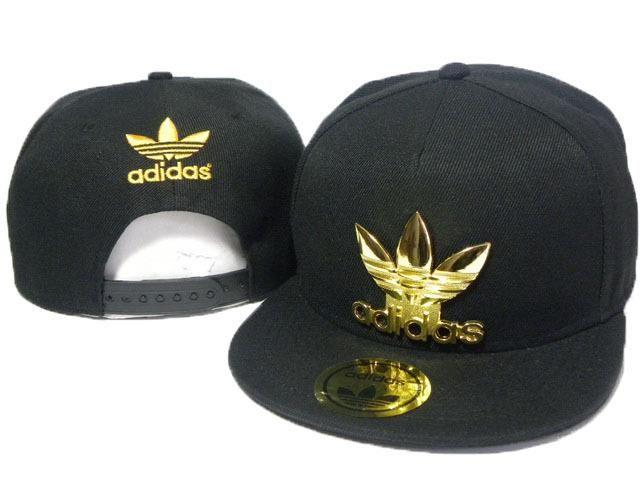 black adidas shirt with gold logo